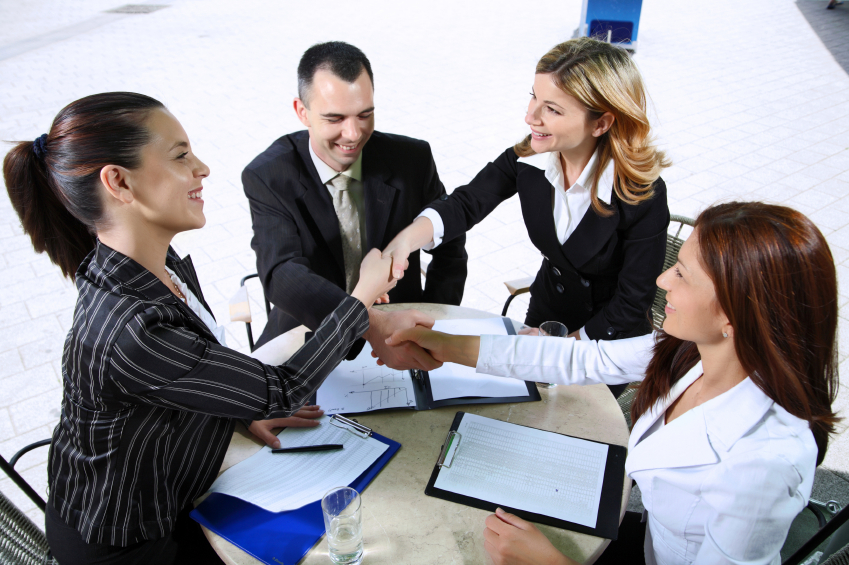Business people shaking hands in a modern downtown.